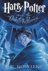 A boy with glasses and a wand in his hand looks over his shoulder.