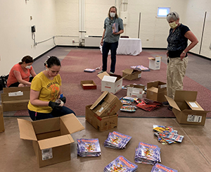 PPLD staff sorts books to be distributed at free meal sites.